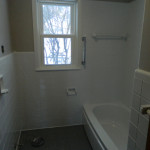 Brown Bathroom After Reglazing the Flloer, Walls, Tub and Tile Surround